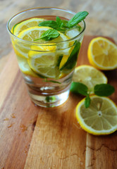 Fresh and cold lemonade with lemons, mint and ice in a glass