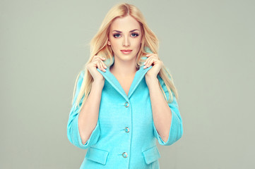 Beautiful model blonde in the blue coat