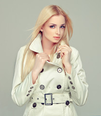 Beautiful model blonde in a gray cloak