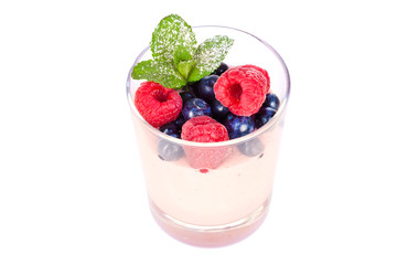 dessert in a glass with berries and mint