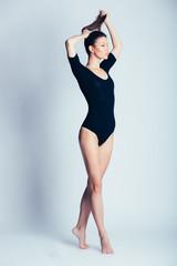 Young and beautiful dancer posing in studio