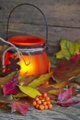 Autumn leaves with lantern abstract background