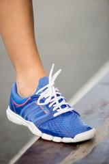 Runnning shoe on runner, close-up