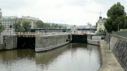lock for ships in the city - bridge with cars