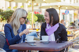 Two female friends meeting for a coffee