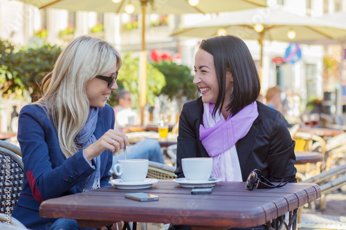 Two female friends meeting for a coffee - 70608199