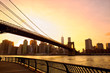 Sunset view Manhattan skyline with Brooklyn Bridge in New York