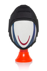 Rugby ball and headgear on tee isolated