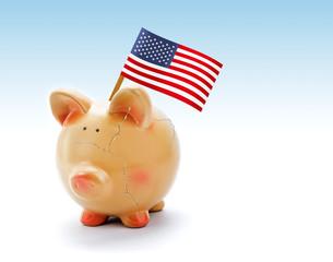 Piggy bank with cracks and national flag of USA
