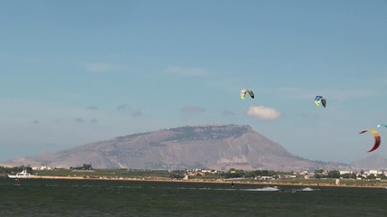 Kitesurfers and windsurfers in the Stagnone lagoon. Sicily