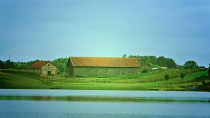 Large barn on the lake.