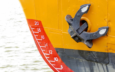 bow of a ship with draft scale numbering and  anchor