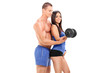 Fitness coach exercising with a female athlete