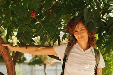 Pretty woman portrait under the tree