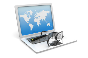Glasses on laptop computer