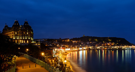 Scarborough Grand Hotel and harbour at night