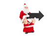 Santa holding black arrow seated on a toilet