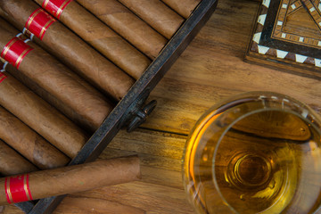 Cigars and Rum or alcohol on table