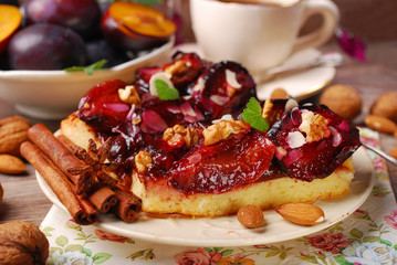 piece of plum cake with nuts and spices