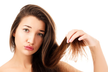 woman showing her fragile hair, white background, copyspace.