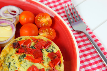 Close up Healthy lunch. Quiche, cheese, tomatoes, red onion