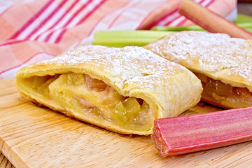 Strudel with rhubarb on linen tablecloth