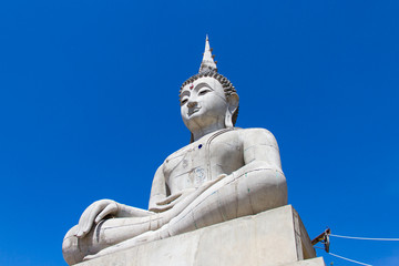 Buddha under construction and blue sky