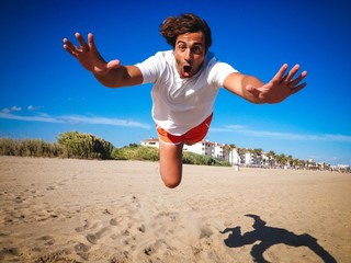 man jumping on a beach
