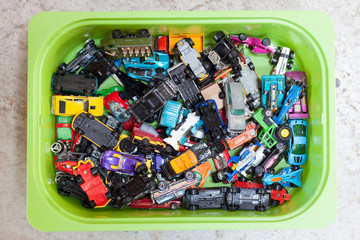 toy cars in plastic container