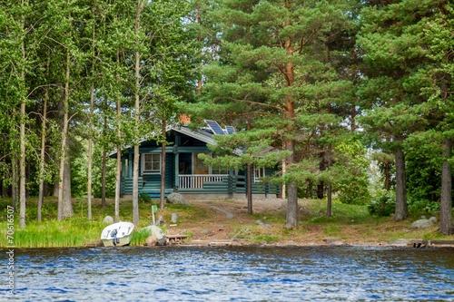 Leinwandbild Motiv Cottage by the lake in rural Finland