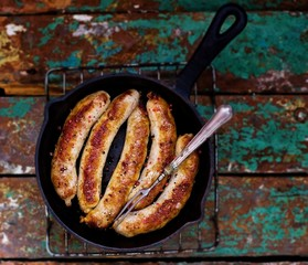 fried sausages on a frying pan