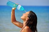 beautiful woman throws fresh water on herself - 70618392