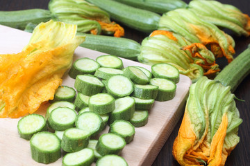 Sliced zucchini on wooden chopping board