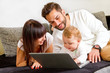 Young, happy family on computer