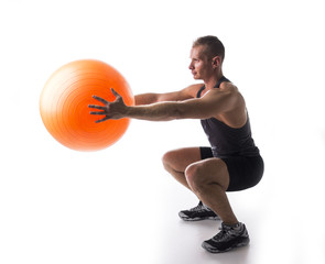 Man working out with a pilates ball