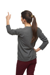 Back view of woman pointing at copy space