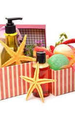 Shampoo, gel bottles, bath bomnbs with starfishes in gift boxes
