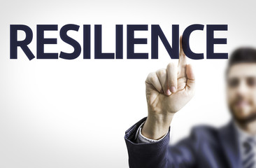 Business man pointing the text: Resilience