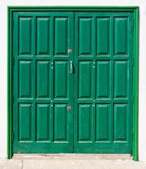 Grüne, kanarische, leicht verwitterte Doppeltür