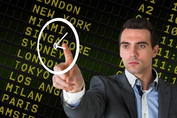 Composite image of handsome young businessman pointing