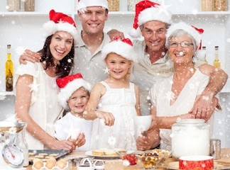 Children baking christmas cakes in the kitchen