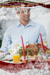 Attractive man sitting at table for christmas dinner