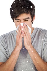 Man using a tissue to blow his nose