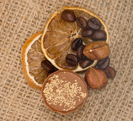 Sweet, lemon, nuts and coffee beans on burlap