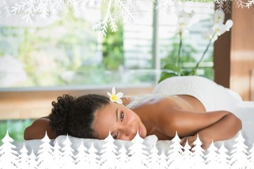 Girl lying on massage table with salt treatment on back