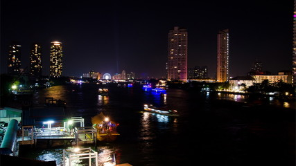 Transport in the river at night, Chao Phraya River Thailand.