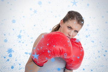 Composite image of sports woman boxing