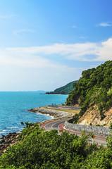 Curve of Mountain Road at sea coastline