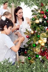 Children and parents decorating a christmas tree