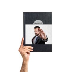 Young businessman doing stop sign printed on book